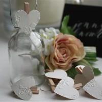 Flower embossed heart pegs