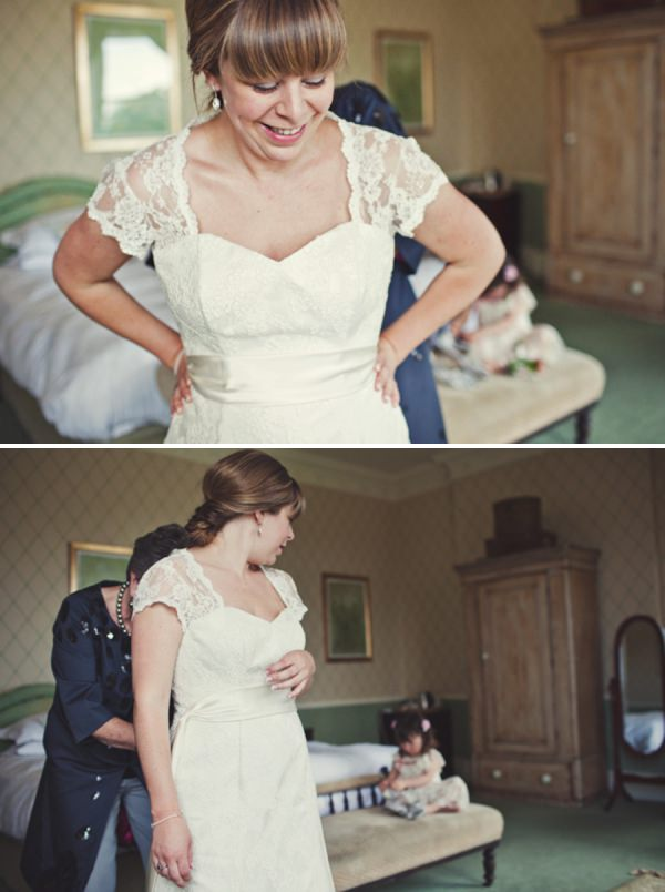 bride getting dressed http://www.joannabrownphotography.com/