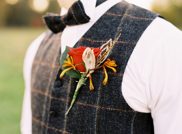 Christmas Buttonhole Feather Rose Rustic Christmas Wedding Ideas http://www.victoriaphippsphotography.co.uk/