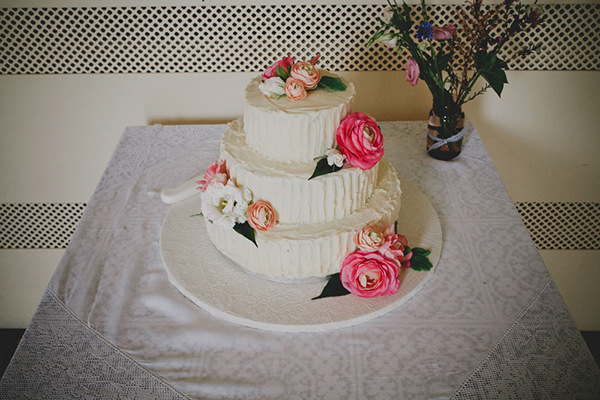 Relaxed Colourful Flower Filled Wedding Rustic Flower Cake http://www.blissfulwedding.co.uk/