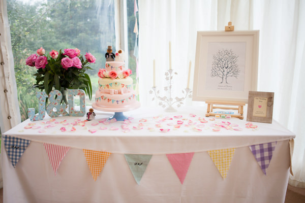 Pretty Pink Country Garden Wedding Bunting Cake http://www.charlotterazzellphotography.com/