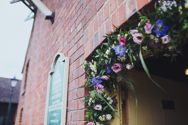 Vintage Colourful Windmill Wedding Flower Arch http://www.gavinphotography.co.uk/