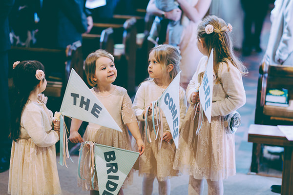 Eclectic Colourful Quirky Village Hall Wedding Here Comes The Bride Sign Flags Flowergirls  http://missgen.com/
