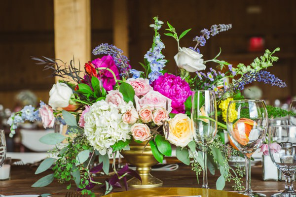 Bohemian Ranch Family Colorado Wedding Colourful Flower Arrangement Table http://fromthehipphoto.com/
