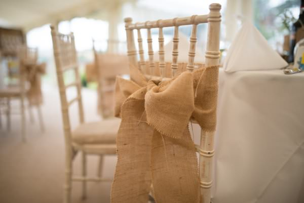 Family Farm Yellow Marquee Wedding Hessian Chair Bows  http://www.fayecornhillphotography.co.uk/