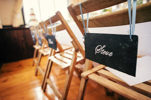 Colourful Homemade Village Hall Wedding Blackboard Chair Signs Decor http://hollydeacondesign.com/