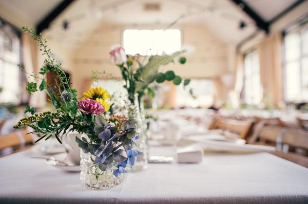 Colourful Homemade Village Hall Wedding Jar Flowers Wild http://hollydeacondesign.com/