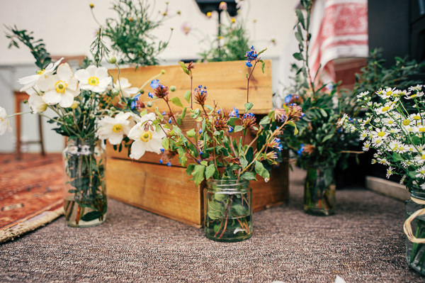 Colourful Homemade Village Hall Wedding Crates Jar Flowers http://hollydeacondesign.com/