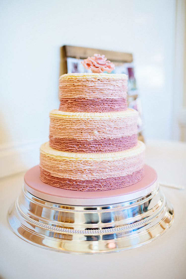 Pink Ombre Ruffle Cake Pretty Quirky DIY Village Hall Wedding http://lauradebourdephotography.com/