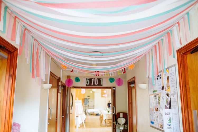 Pretty pink quirky diy village hall wedding whimsical for Decor using crepe paper