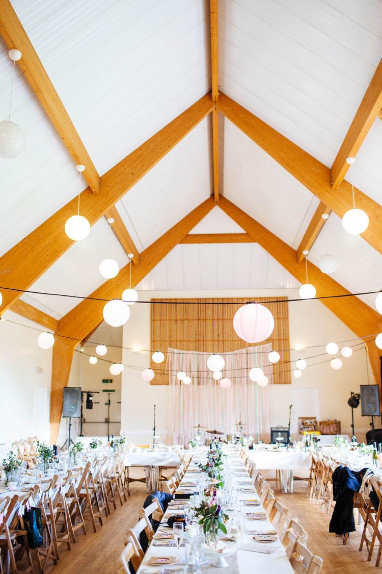 Light Lanterns Pretty Quirky DIY Village Hall Wedding http://lauradebourdephotography.com/