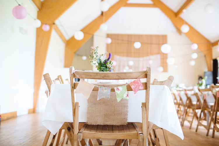 Chair Bunting Pretty Quirky DIY Village Hall Wedding http://lauradebourdephotography.com/