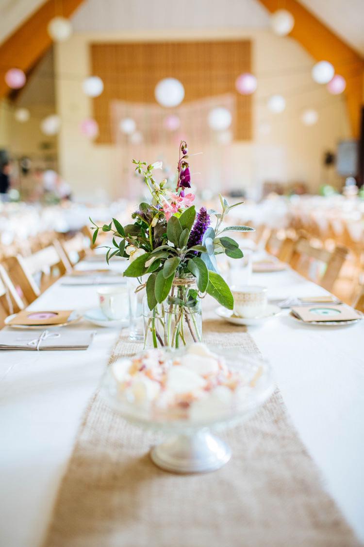 Jar Flowers Table Centrepiece Pretty Quirky DIY Village Hall Wedding http://lauradebourdephotography.com/