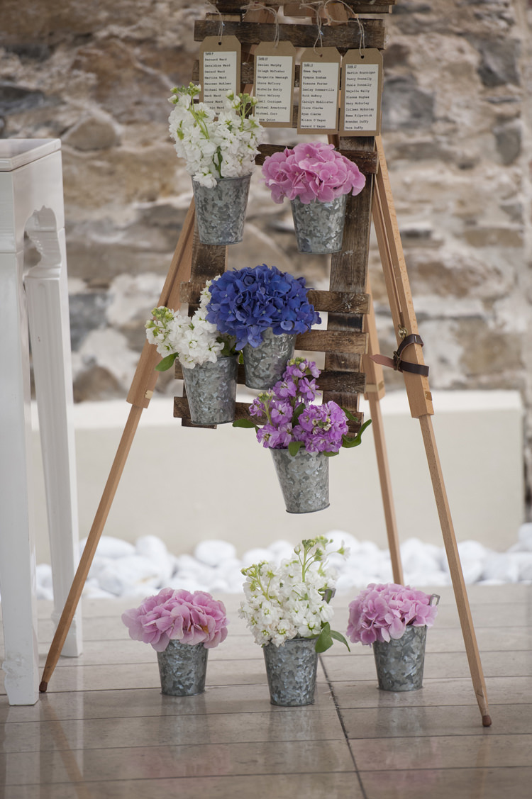 Flowers Pots Table Seating Plan Relaxed Bohemian Glamour Pink Blue Wedding http://sarahfyffe.ie/