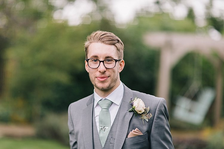 Groom Glasses Grey Suit Sage Green Tie Pink Rose Buttonhole Soft Whimsical Natural Rustic Wedding http://emilyhannah.com/