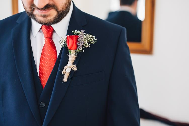 Red Tie Rose Buttonhole Groom Colourful Festival Glamping Fete Games Wedding http://www.newforeststudio.com/