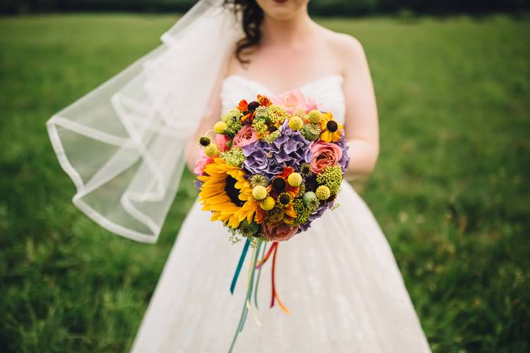 Sunflowers Billy Balls Purple Yellow Bouquet Ribbons Bride Bridal Flowers Colourful Festival Glamping Fete Games Wedding http://www.newforeststudio.com/