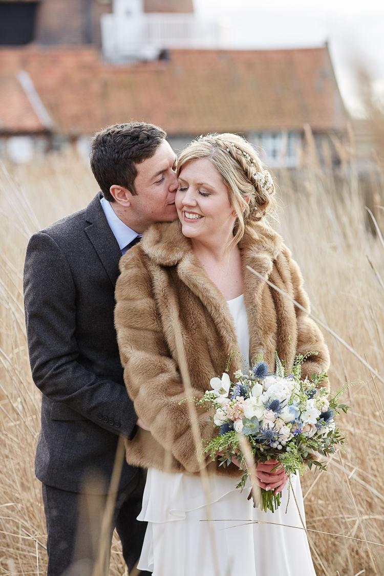 Faux Fur Coat Bride Quaint Rustic Seaside Windmill Wedding Norfolk http://www.fullerphotographyweddings.co.uk/