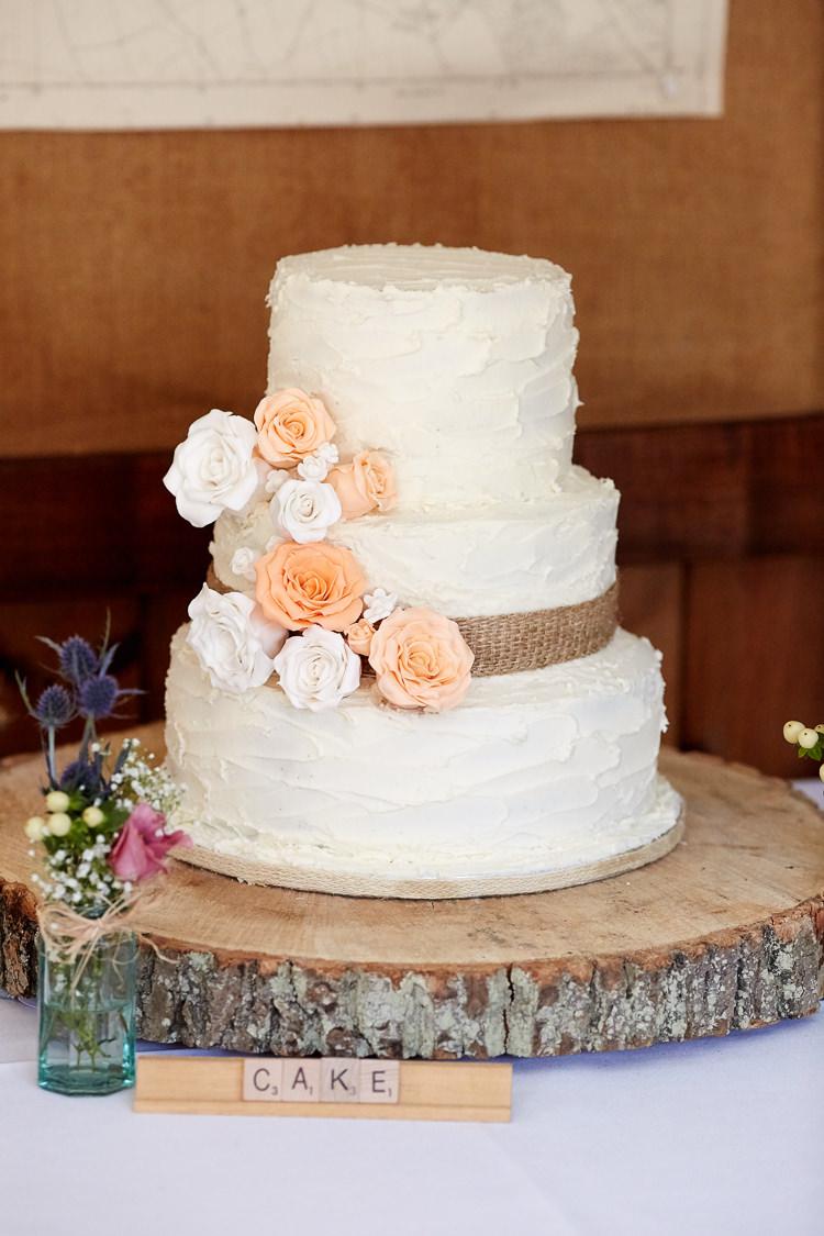 Icing Flowers Hessian Log Cake Quaint Rustic Seaside Windmill Wedding Norfolk http://www.fullerphotographyweddings.co.uk/