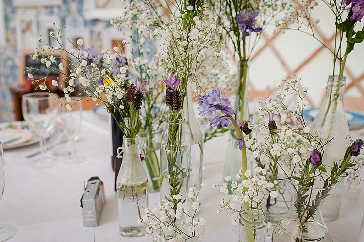 Wild Flowers Bottles Pretty Tables Centrepiece Colourful Outdoor Woodland DIY Yurt Wedding http://alexa-loy.com/
