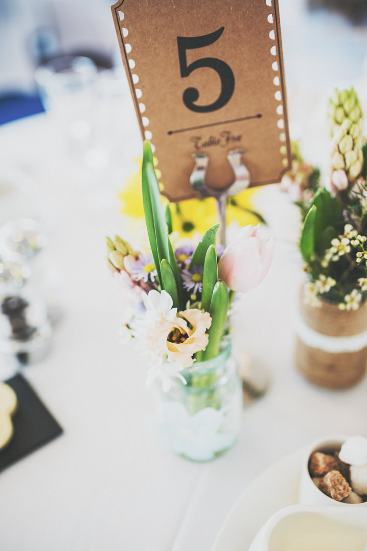 Tulips Bulbs Jar Flowers Table Numers Brown Paper Pretty Spring Country Rustic Wedding Northamptonshire Racecourse http://www.frankee-victoria.co.uk/