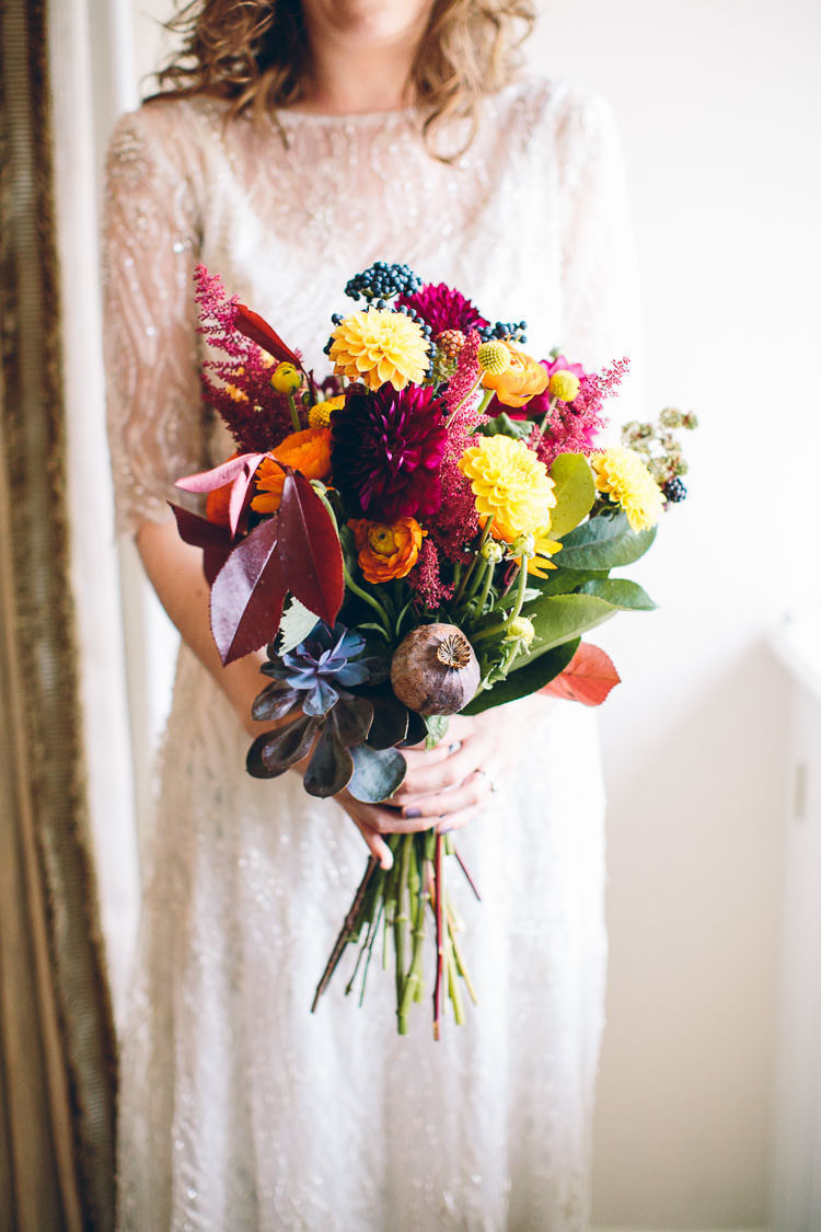 Autumn Flowers Bouquet Orange Red Yellow Dahlias Bride Bridal Cotswolds Barn Laid Back Stylish Wedding http://albertpalmerphotography.com/