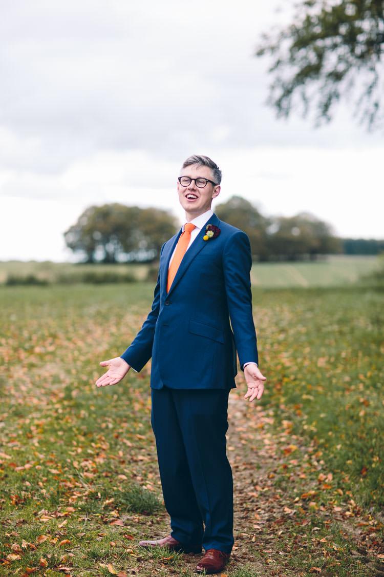 Navy Suit Orange Tie Groom Cotswolds Barn Laid Back Stylish Wedding http://albertpalmerphotography.com/