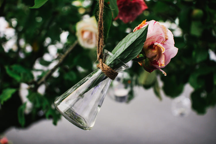 Jars Bottles Roses Flowers Beautiful English Garden Blooms Marquee Wedding http://www.sansomphotography.co.uk/