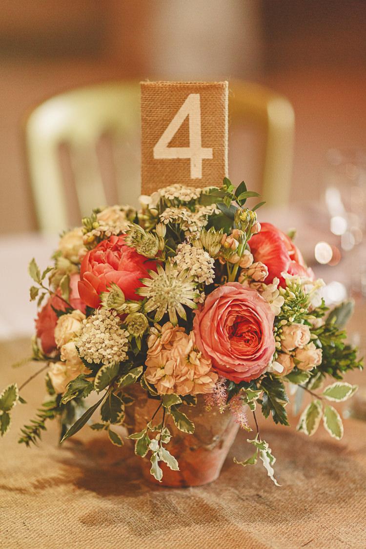 Peonies Roses Flowers Centrepiece Hessian Numbers Decor Relaxed Rustic Coral Peony Barn Wedding http://www.benjaminstuart.co.uk/