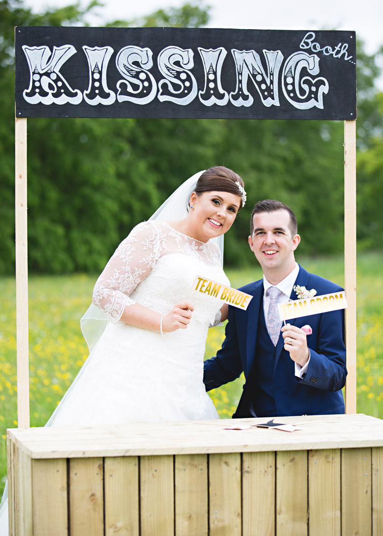 Kissing Booth Creative DIY Outdoor Tipi Field Wedding http://hbaphotography.com/