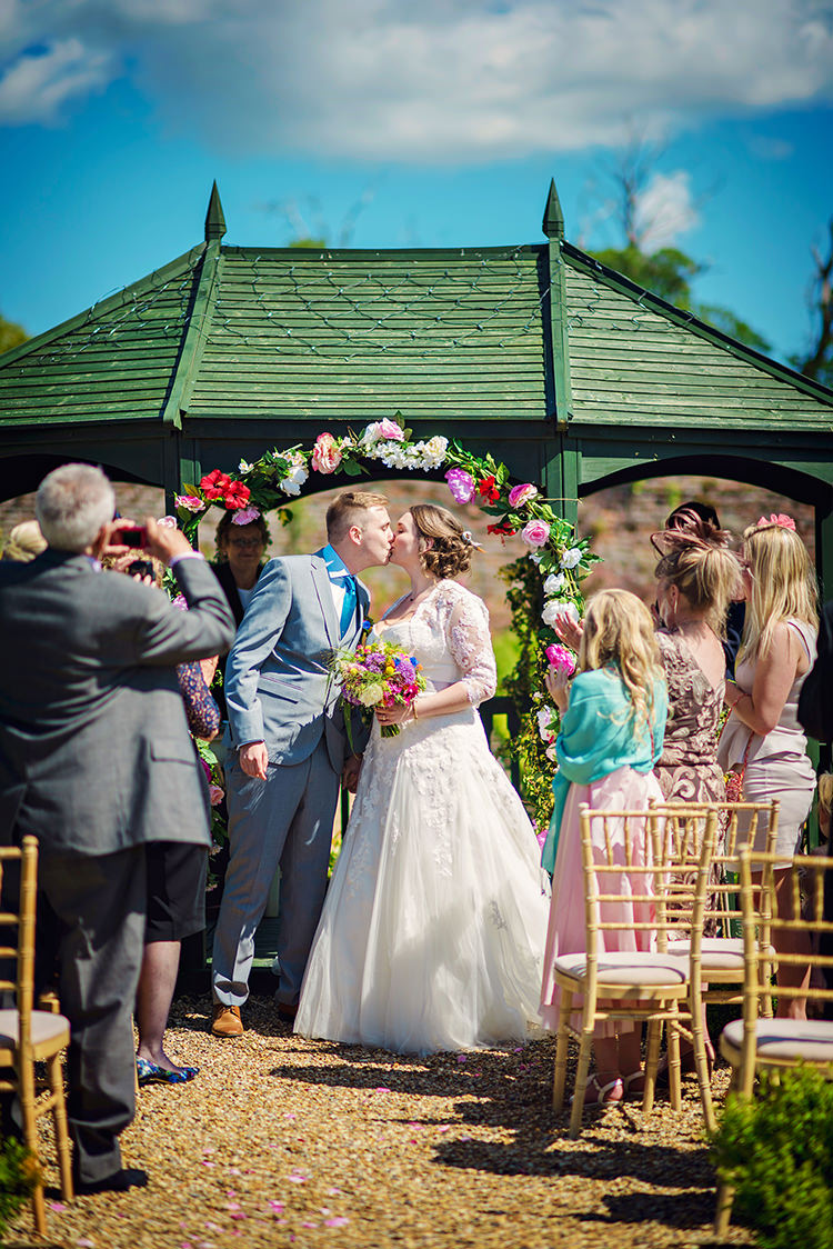 Flower Arch Outdoor Ceremony UK Relaxed Country Outdoor Flowers Bright Summer Wedding http://www.photographybyvicki.co.uk/
