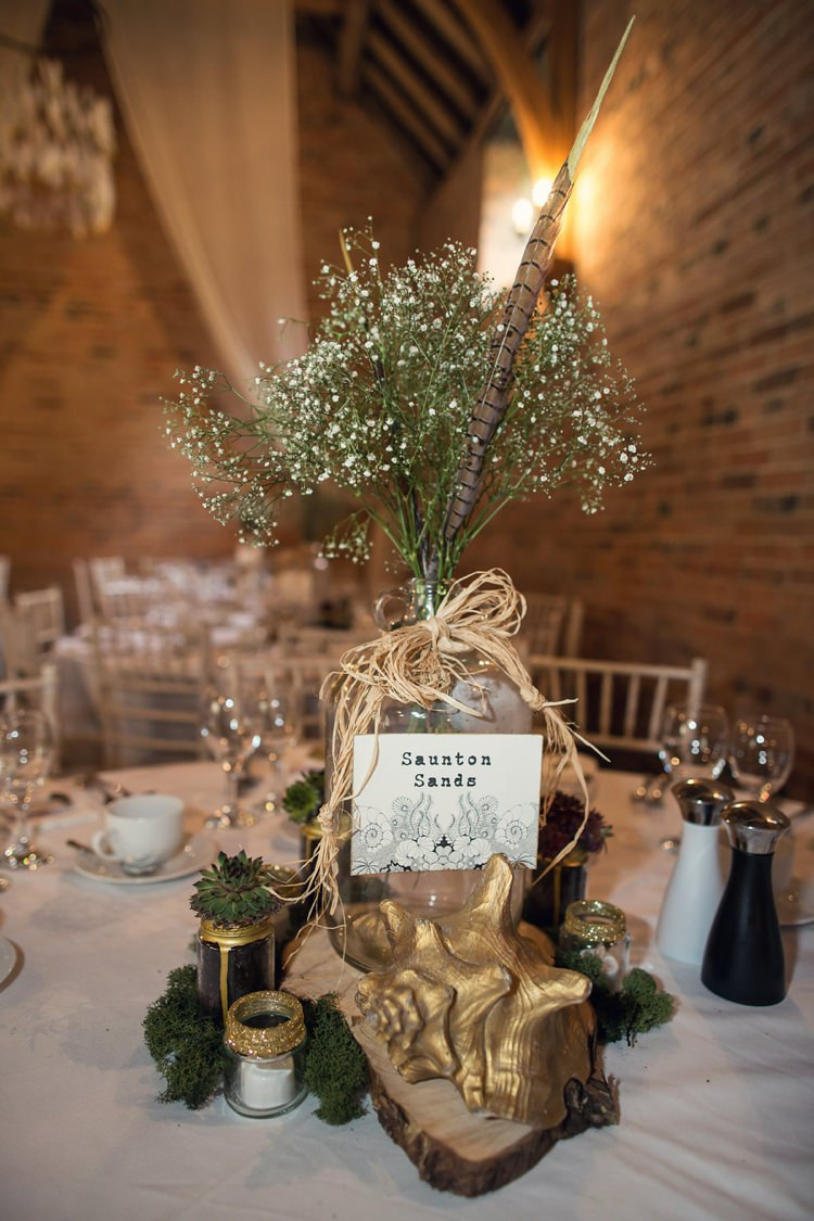 Centrepiece Gypsophila Flowers Log Gold Indie Glam Feathers Shells Slate Sea Inspired Wedding http://assassynation.co.uk/