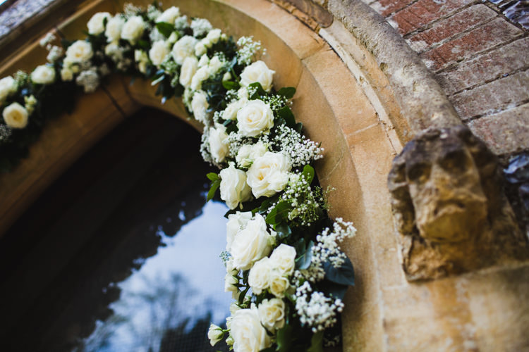 White Rose Gypsophila Arch Church Flowers Very Casual Country Barn Wedding http://amybphotography.co.uk/