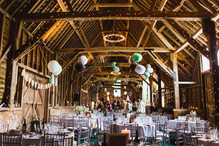 North Hidden Barn Fairy Lights Pom Poms Very Casual Country Barn Wedding http://amybphotography.co.uk/