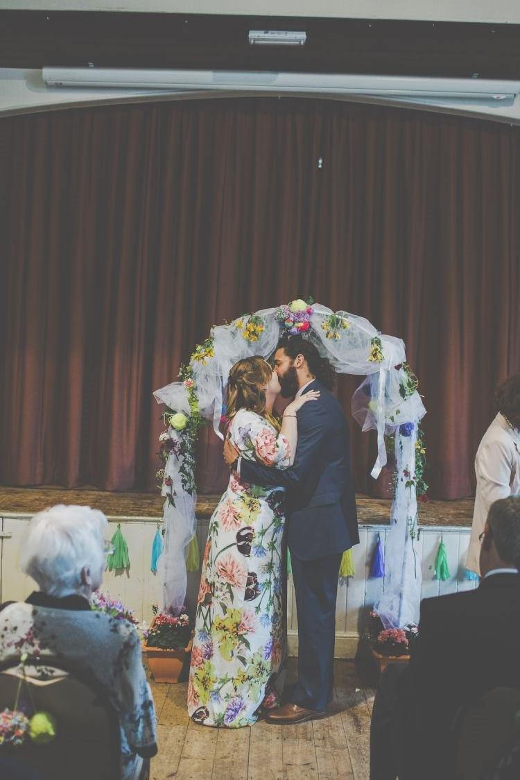 Arch Backdrop Ceremony Flowers Bright Fun Multicoloured Wool Pom Pom Crafty Wedding http://meliamelia.com/