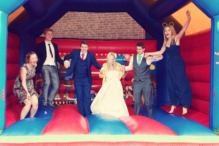 Bouncy Castle Rainbow Mismatched Kids Party Wedding http://www.jessicaraphaelphotography.com/