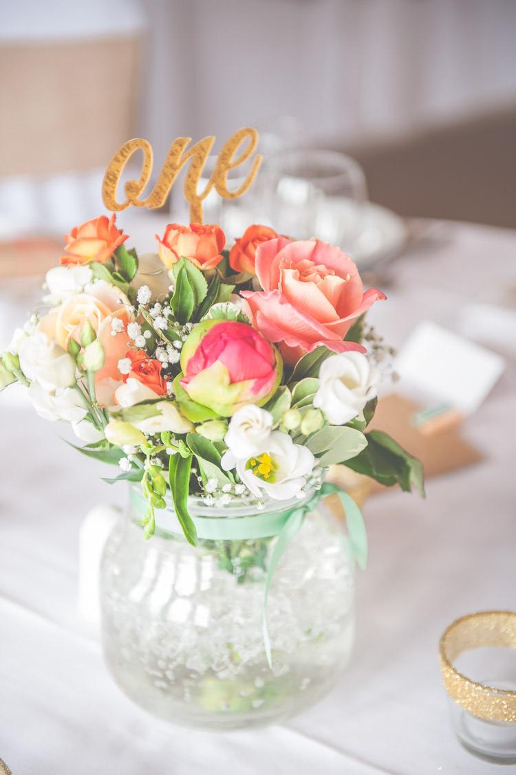 Gold Glitter Table Numbers Flowers Roses Vase Fresh Relaxed Peach Barn Wedding http://lisahowardphotography.co.uk/