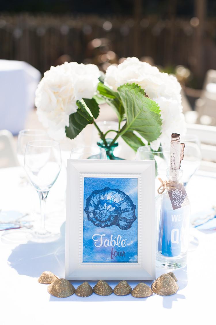 Shell Table Names Stylish Beach Mermaid Wonderland Wedding http://www.sourceimages.co.uk/