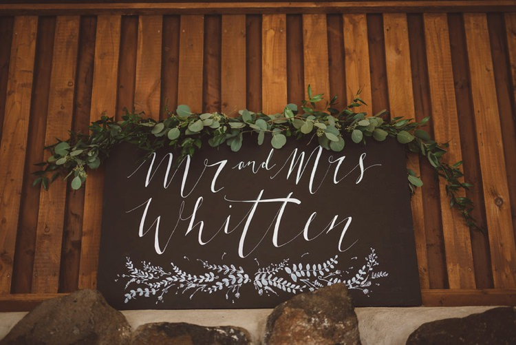 Top Table Sign Calligraphy Black Board Greenery Whimsical Boho Woodland Wedding http://katmervynphotography.com/