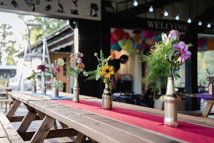 Picnic Tables Flowers Bottles Colourful Rainbow Gold Camp Wedding Party http://alexa-loy.com/