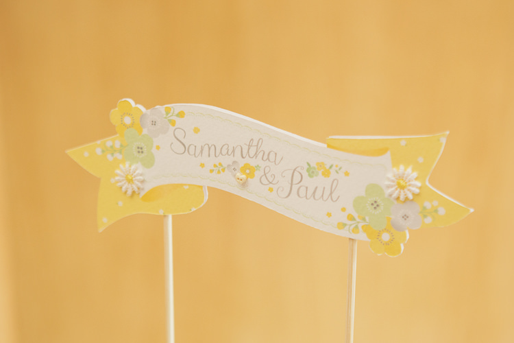 Floral Paper Cake Topper Banner Quirky Relaxed Yellow Country Wedding http://www.mr-and-mrs-wedding-photography.co.uk/