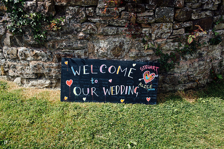 Colourful Blackboard Sign Welcome Woodland Farm Camping Weekend Wedding http://www.frecklephotography.co.uk/