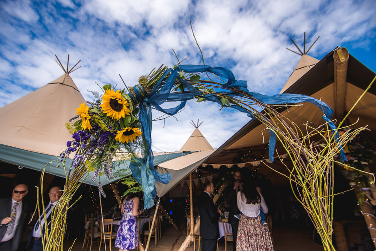 Floral Flower Arch Mismatched Farm Tipi Wedding http://www.andrewkeher.co.uk/