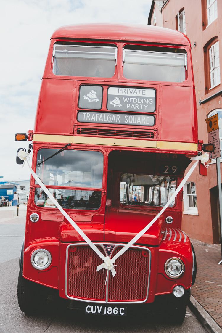 Red London Bus Durdle Door Cliff Wedding http://www.paulunderhill.com/