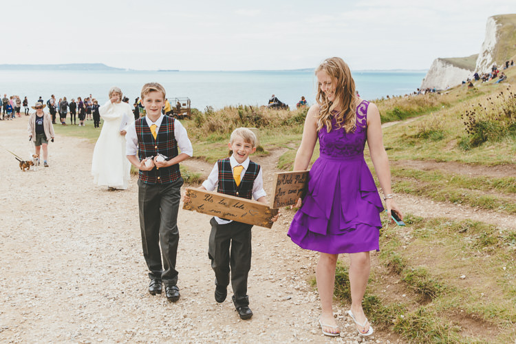 Page Boys Here Comes Your Bride Sign Durdle Door Cliff Wedding http://www.paulunderhill.com/