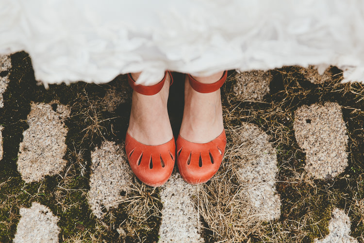 Clogs Bride Red Shoes Durdle Door Cliff Wedding http://www.paulunderhill.com/