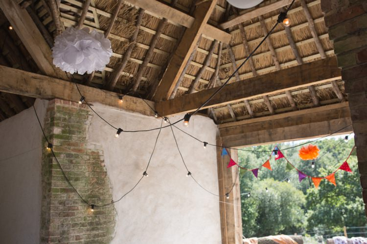 Festoon Lights Pom Poms Farm Barn Wedding http://www.florencefox.com/