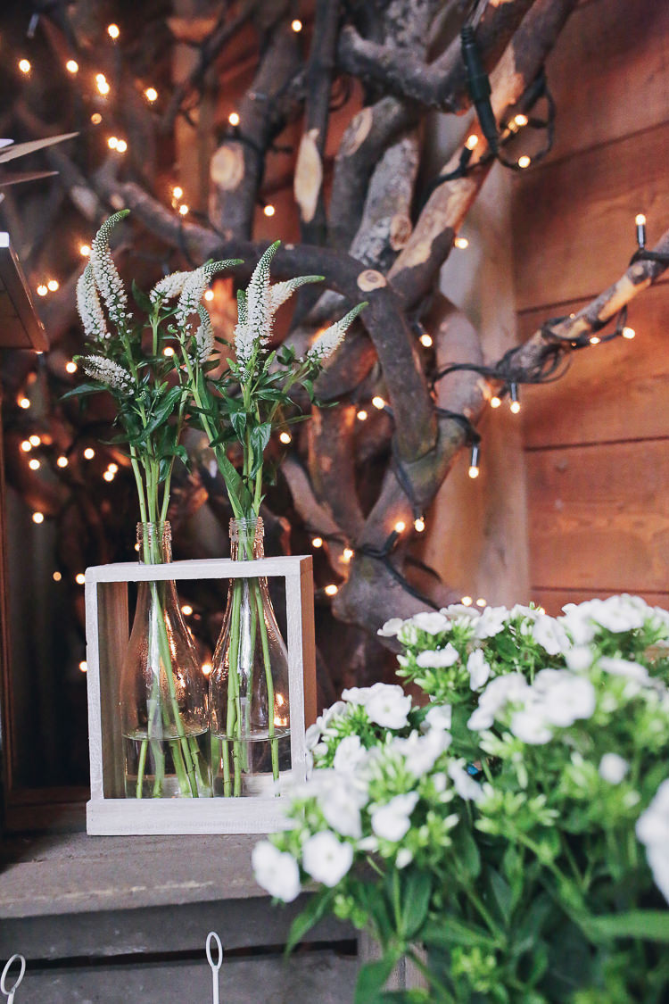White Bottle Flowers Rustic Treehouse Wedding http://helenrussellphotography.co.uk/