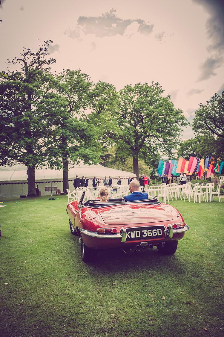 Classic Red Convertable Glastonbury Festival Garden Party Wedding http://www.tommyreynoldsweddings.co.uk/