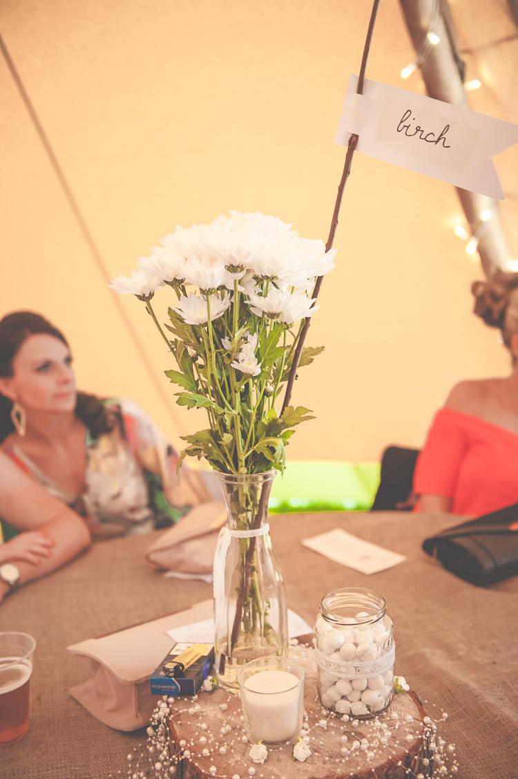 White Flowers Bottle Log Centrepiece Quirky Natural Woodland Wedding http://lisahowardphotography.co.uk/